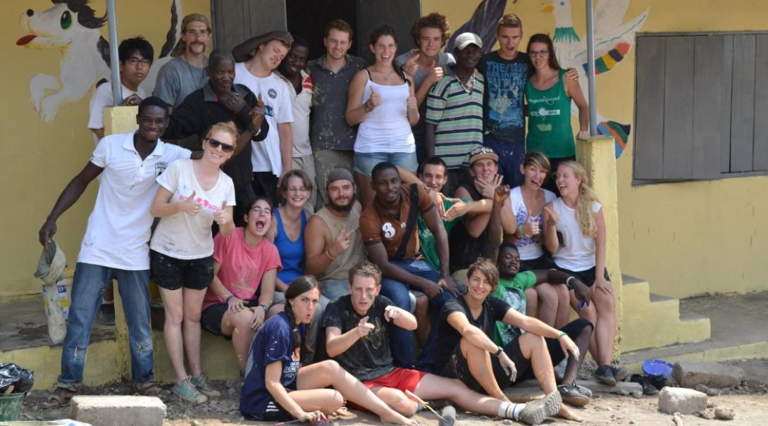 A group relaxing after doing some painting in Ghana
